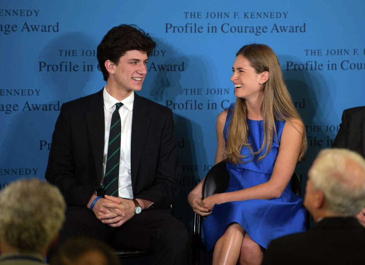 Lauren Bush Lauren, right, granddaughter of former President George H.W. Bush, laughs with Jack Schlossberg, grandson of former President John F. Kennedy, before accepting the 2014 John F. Kennedy Profile in Courage Award on behalf of her grandfather during a ceremony at the John F. Kennedy Library and Museum Sunday, May 4, 2014, in Boston. (AP Photo/Gretchen Ertl)