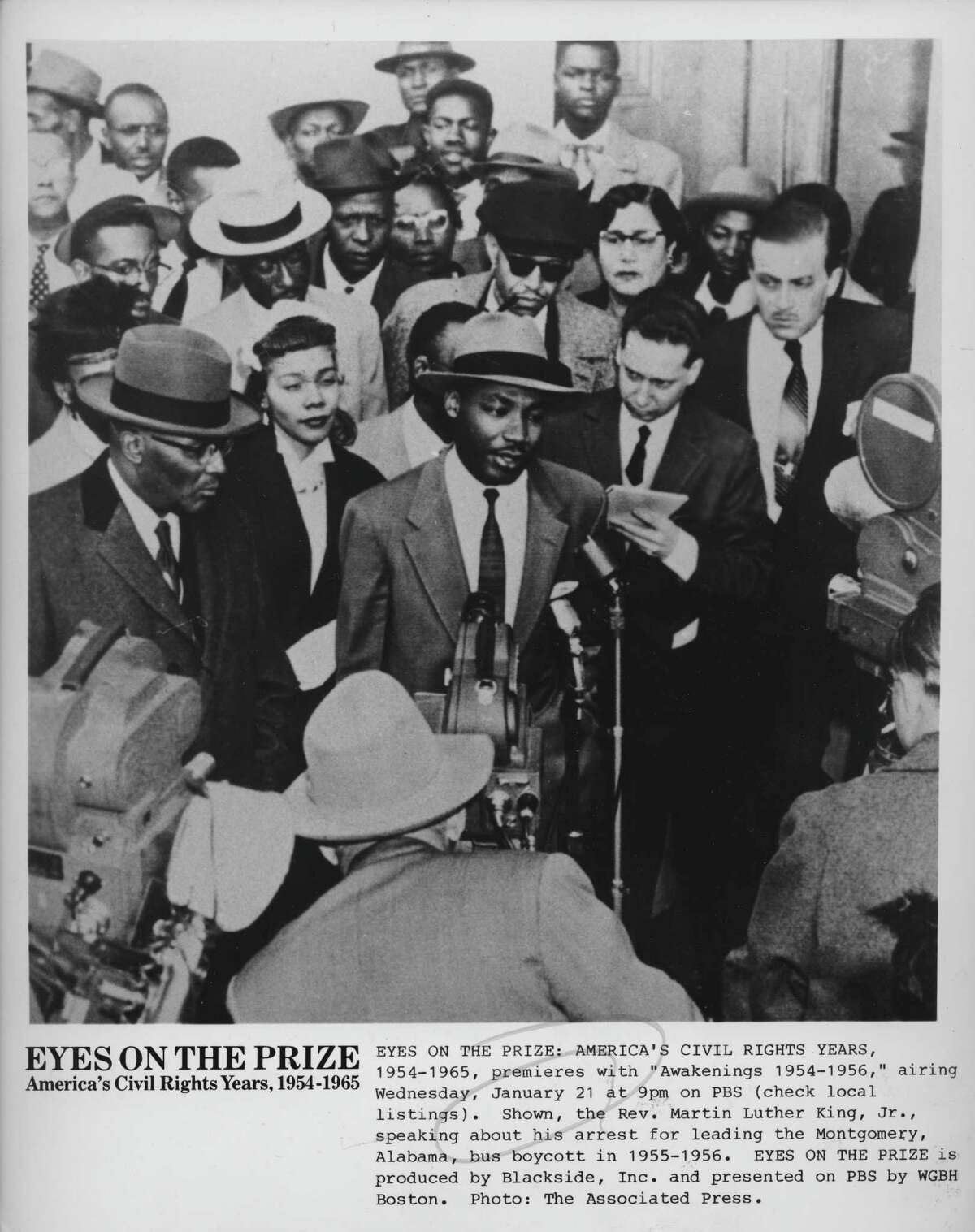 """Martin Luther King Jr. speaks to reporters about his arrest for leading the Montgomery, Ala., bus boycott in 1955-56 in an image that was included in the 1987-88 TV documentary """"Eyes on the Prize."""""""