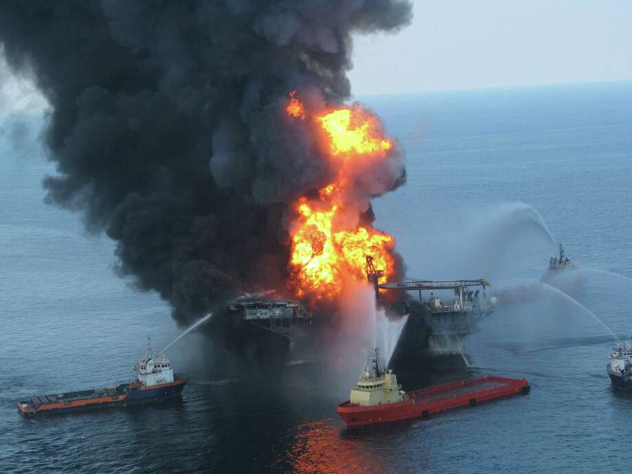 Fire boats  battle the blazing remnants of the oil rig Deepwater Horizon after the blowout of BP's Macondo well in of 2010. (U.S. Coast Guard) Photo: HO, Handout / AFP ImageForum