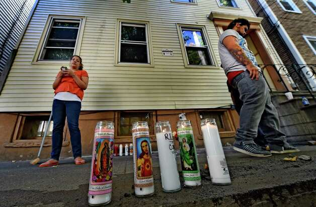 Friends of shooting victim Jorge Falu-Garcia set up a memorial in front of 352 First St. where blood stains were washed from the sidewalk and memorial candles were put in its place Friday afternoon Oct. 3, 2014 in Albany, N.Y.  The friends are; left to right,  Breanna Maisonet, left and Noah Maisonet, right.    (Skip Dickstein/Times Union) Photo: SKIP DICKSTEIN