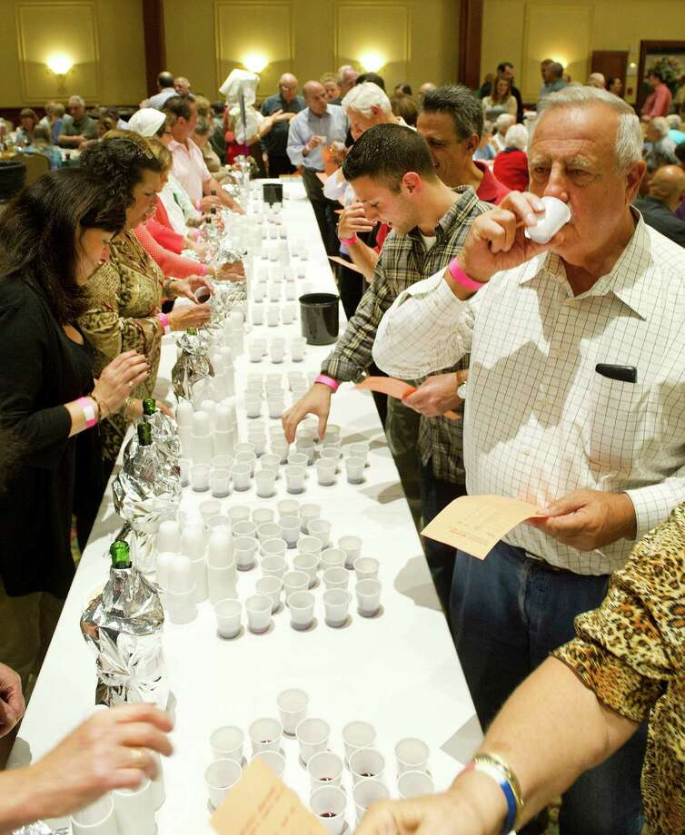 Red wines are tasted during the 22nd annual homemade wine tasting contest at the Italian Center in Stamford, Conn., on Friday, October 3, 2014. Photo: Lindsay Perry / Stamford Advocate