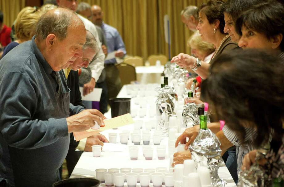 Dominic Greco tastes a red wine during the 22nd annual homemade wine tasting contest at the Italian Center in Stamford, Conn., on Friday, October 3, 2014. Photo: Lindsay Perry / Stamford Advocate