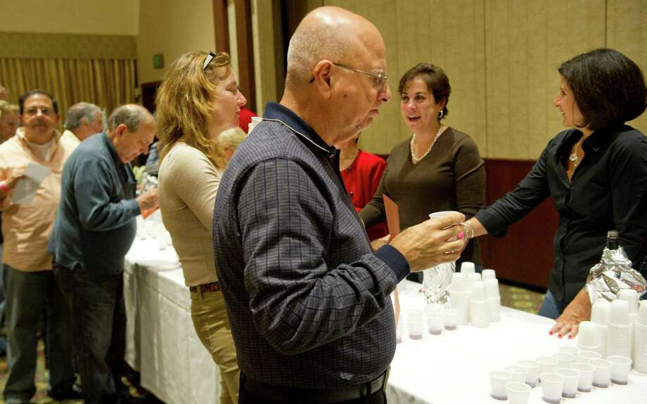 Albert Aquila tastes a red wine during the 22nd annual homemade wine tasting contest at the Italian Center in Stamford, Conn., on Friday, October 3, 2014. Photo: Lindsay Perry / Stamford Advocate