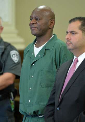 Andre McClenos, left, stands before judge Andrew Ceresia and is arraigned on rape charges in Rensselaer County Court Friday morning Oct. 3, 2014 in Troy, N.Y.  With McClenos is his defense attorney Mike Jurena.  (Skip Dickstein/Times Union) Photo: SKIP DICKSTEIN / 00028868A