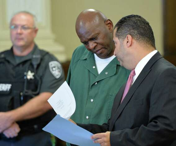 Andre McClenos, center, confers with his attorney Mike Jurena, right, during his arraignment on rape charges in Rensselaer County Court Friday morning Oct. 3, 2014 in Troy, N.Y.  With McClenos is his defense attorney Mike Jurena.  (Skip Dickstein/Times Union) Photo: SKIP DICKSTEIN / 00028868A