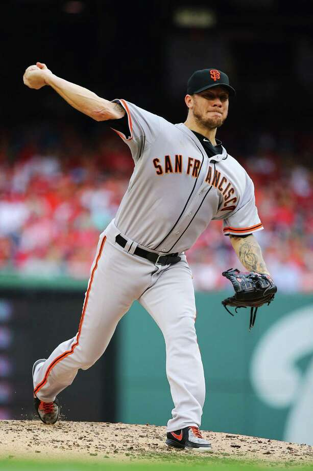 WASHINGTON, DC - OCTOBER 03:  Jake Peavy #22 of the San Francisco Giants pitches against the Washington Nationals during Game One of the National League Division Series at Nationals Park on October 3, 2014 in Washington, DC.  (Photo by Al Bello/Getty Images) ORG XMIT: 516380925 Photo: Al Bello / 2014 Getty Images