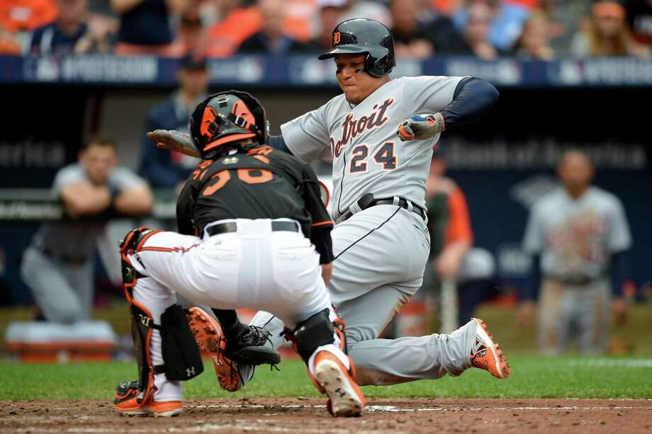 Baltimore Orioles catcher Caleb Joseph tags out Detroit Tigers' Miguel Cabrera at home plate on Detroit Tigers designated hitter Victor Martinez's double in the eighth inning of Game 2 in baseball's AL Division Series in Baltimore, Friday, Oct. 3, 2014. Baltimore won 7-6. (AP Photo/Nick Wass) ORG XMIT: BAB129 Photo: Nick Wass / FR67404 AP