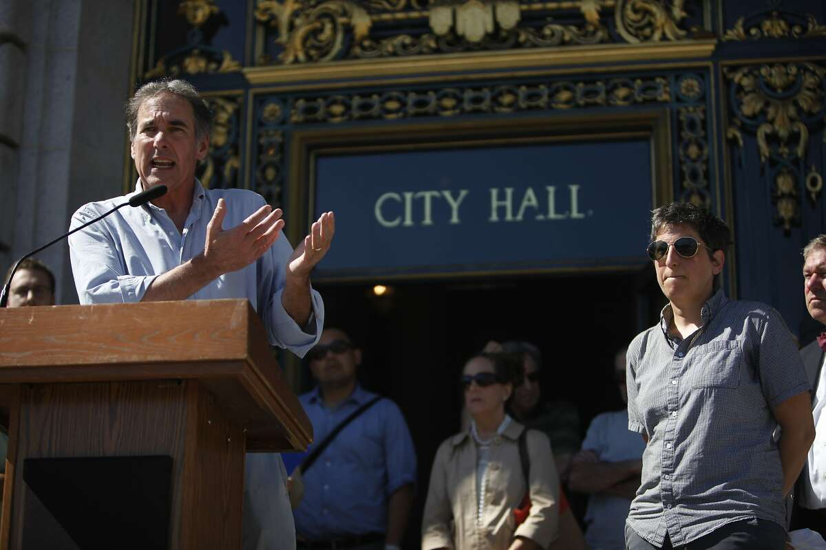 Mike Casey (left), president UNITE HERE Local 2, speaks during a rally opposing proposed legislation to regulate Airbnb at City Hall on Friday, October 3, 2014 in San Francisco, Calif.