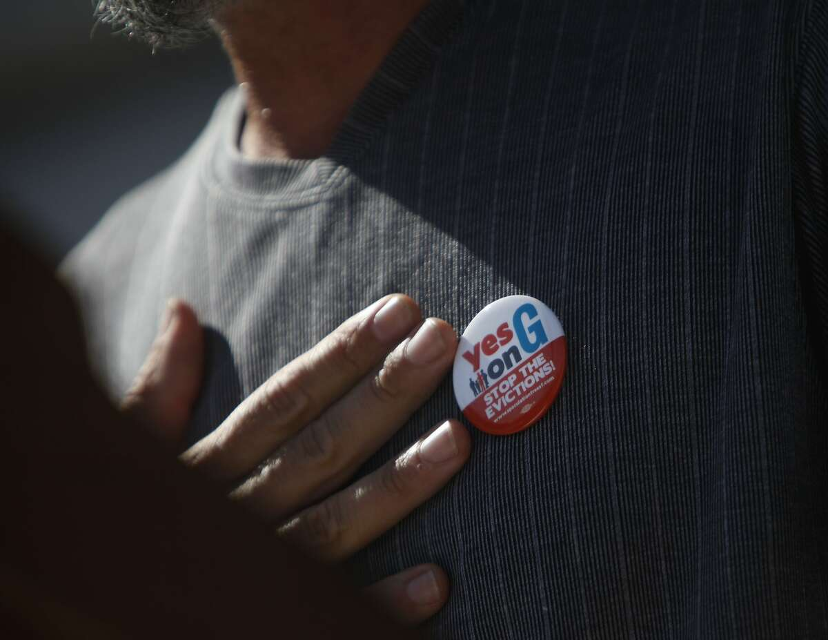 Fernando Marti, Council of Community Housing Organizations co-director, wears a Yes on G button as he speaks during a rally opposing proposed legislation to regulate Airbnb at City Hall on Friday, October 3, 2014 in San Francisco, Calif.