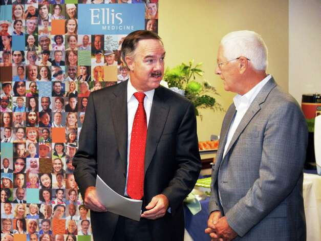 President and CEO of Ellis Medicine, James W. Connolly, left, and Malta Town Supervisor Paul Sausville during the opening of Ellis Medicine's newest primary care practice and blood draw lab on Route 9 Friday Oct. 3, 2014, in Malta, NY.  (John Carl D'Annibale / Times Union) Photo: John Carl D'Annibale / 00028879A