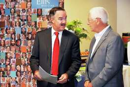 President and CEO of Ellis Medicine, James W. Connolly, left, and Malta Town Supervisor Paul Sausville during the opening of Ellis Medicine's newest primary care practice and blood draw lab on Route 9 Friday Oct. 3, 2014, in Malta, NY.  (John Carl D'Annibale / Times Union)