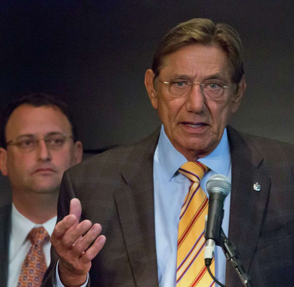 """John Couris, left, president and CEO of Jupiter Medical Center, listens as legendary New York Jets quarterback Joe Namath speaks during a press conference, Tuesday, Sept. 30, 2014 in New York. Namath shared his personal story of concussions after announcing the creation of the Joe Namath Medical Research Center at Jupiter Medical Center in Florida. The center, where Namath has gone for treatment, focuses on research to """"combat the debilitating effects of traumatic brain injuries,"""" according to a press release statement. (AP Photo/Bebeto Matthews)"""