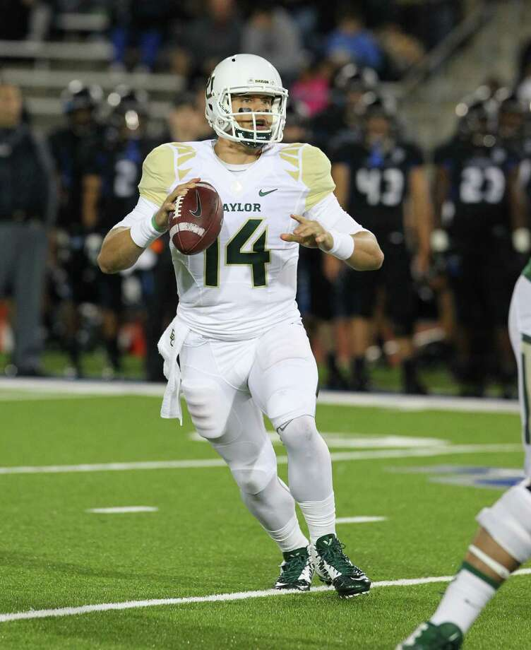QB Bryce Petty has fueled the nation's top offense, helping make Baylor a 15-point favorite over Texas. Photo: Bill Wippert, FRE / FR170745 AP