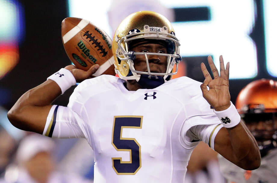 Notre Dame quarterback Everett Golson looks to pass against Syracuse during the first half of an NCAA college football game, Saturday, Sept. 27, 2014, in East Rutherford, N.J. Notre Dame won 31-15. (AP Photo/Julio Cortez) ORG XMIT: NJJC117 Photo: Julio Cortez / AP