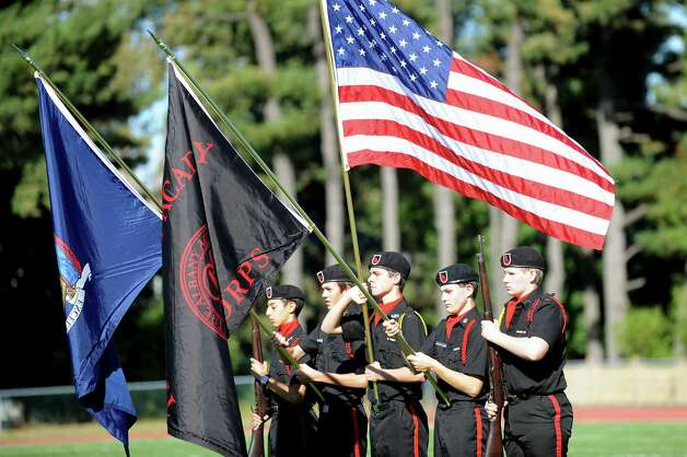 The Albany Academy Cadet Corps holds flags for the National Anthem before their football game against Schuylerville on Friday, Oct. 3, 2014, at Albany Academy in Albany, N.Y. (Cindy Schultz / Times Union) Photo: Cindy Schultz / 00028780A