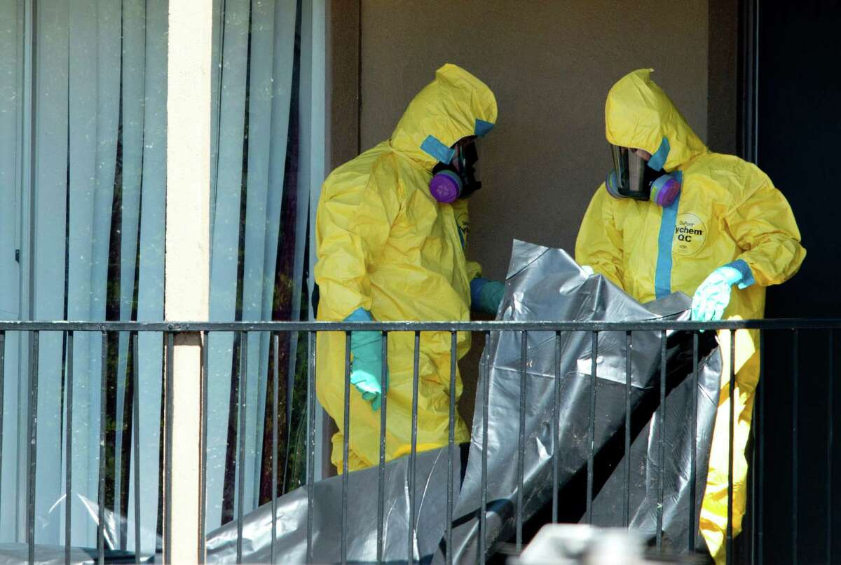 A hazardous materials crew prepares to enter the unit at the Dallas apartment building where Thomas Duncan fell ill with Ebola in 2014.