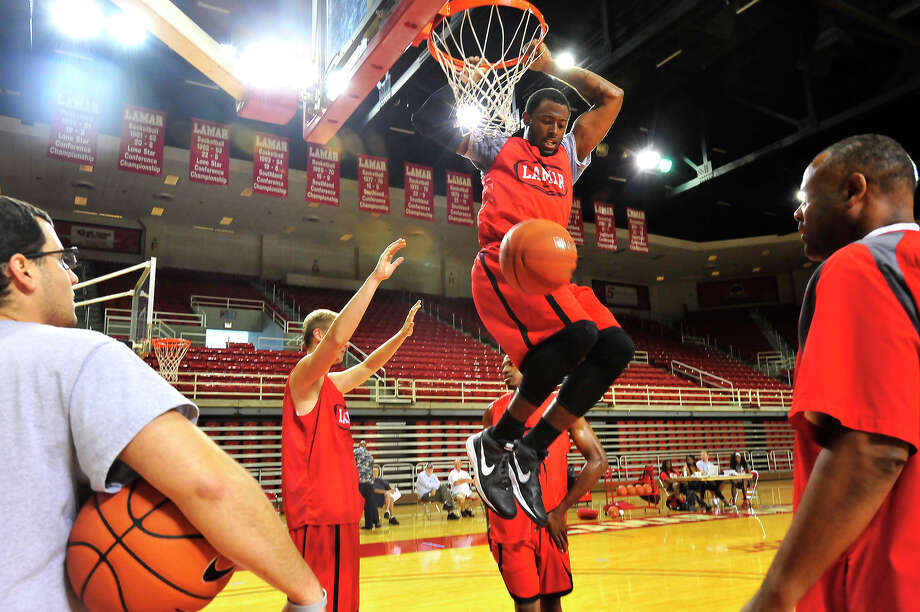 Lamar University's Donovan Ross dunks the ball after getting through the defensive pressure of teammates on the opening day of the men's basketball practice Friday in the Montagne Center. Photo taken Friday, October 3, 2014 Kim Brent/@kimbpix Photo: KIM BRENT / Beaumont Enterprise