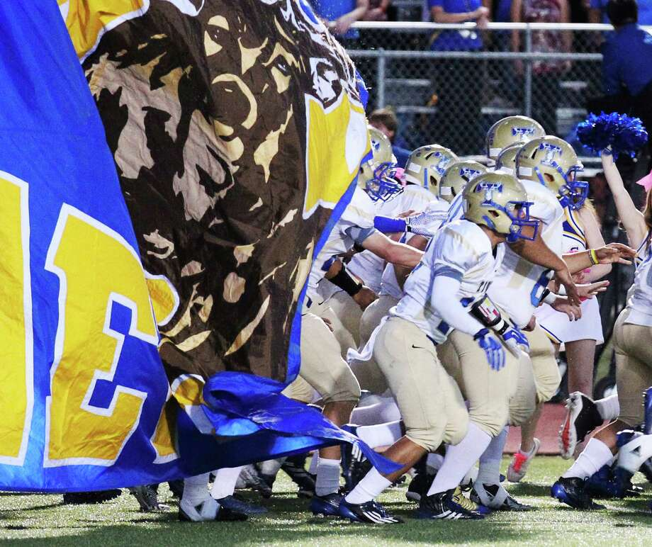 The Kerrville Tivy Fighting Antlers take the field for the game against Boerne Champion in Boerne on Friday, Oct. 3, 2014. Photo: Kin Man Hui, San Antonio Express-News / ©2014 San Antonio Express-News