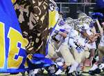 The Kerrville Tivy Fighting Antlers take the field for the game against Boerne Champion in Boerne on Friday, Oct. 3, 2014.