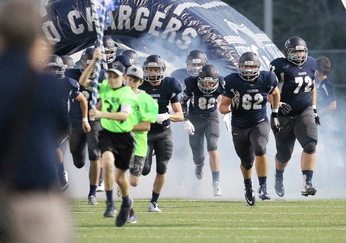 The Boerne Champion Chargers take the field against Kerrville Tivy in Boerne on Friday, Oct. 3, 2014.