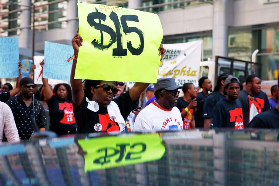 Protesters in Philadephia push for higher pay. Strong job growth usually fuels rising wages Photo: Matt Rourke, STF / AP