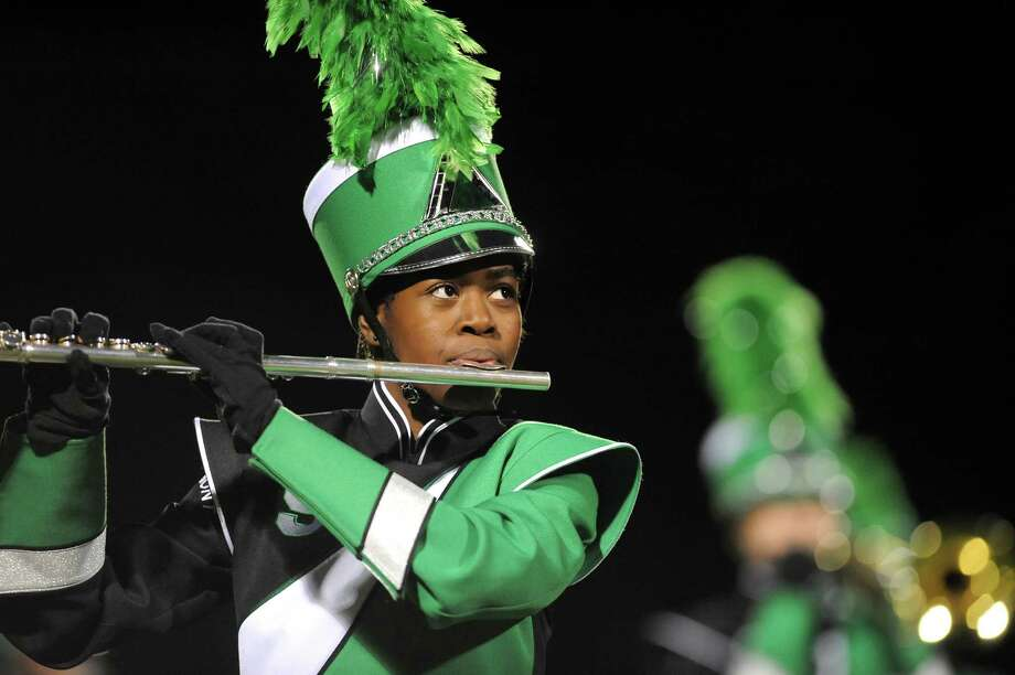 Tralyn Randle, 17, plays the flute as the Schalmont Marching Band performs at halftime during their football game against Ravena on Friday, Oct. 3, 2014, at Schalmont High in Rotterdam, N.Y. (Cindy Schultz / Times Union) Photo: Cindy Schultz / 00028779A