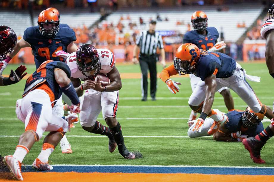 SYRACUSE, NY - OCTOBER 03:  Brandon Radcliff #23 of the Louisville Cardinals scores a touchdown in the first quarter against the Syracuse Orange on October 3, 2014 at The Carrier Dome in Syracuse, New York.  (Photo by Brett Carlsen/Getty Images) ORG XMIT: 515431853 Photo: Brett Carlsen / 2014 Getty Images