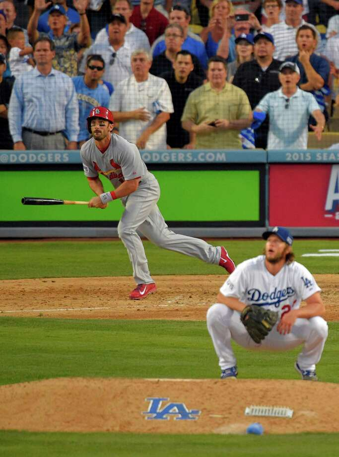 St. Louis Cardinals' Matt Carpenter, center, watches his a three-run double as Los Angeles Dodgers starting pitcher Clayton Kershaw, right, crouches on the mound in the seventh inning of Game 1 of baseball's NL Division Series in Los Angeles, Friday, Oct. 3, 2014. (AP Photo/Mark J. Terrill) ORG XMIT: LAD178 Photo: Mark J. Terrill / AP