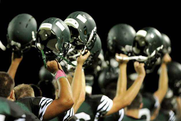 Schalmont's team raises their helmets before the start of their football game against Ravena on Friday, Oct. 3, 2014, at Schalmont High in Rotterdam, N.Y. (Cindy Schultz / Times Union) Photo: Cindy Schultz / 00028779A