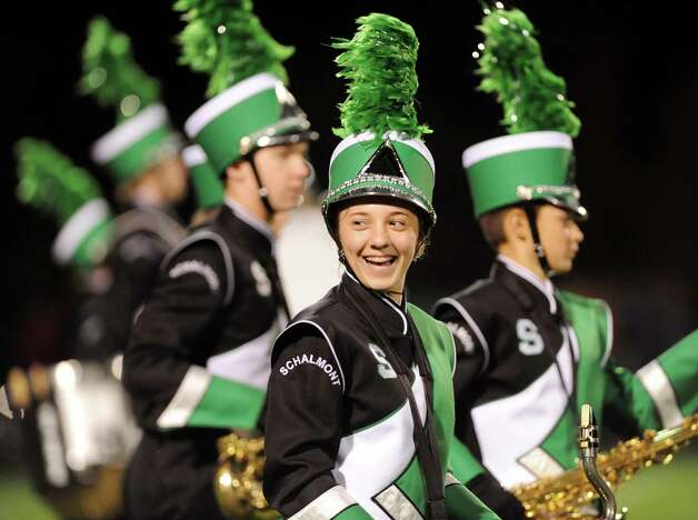 Bass clarinetist Hannah List, 15, center, takes the field with the Schalmont Marching Band for the halftime performance during their football game against Ravena on Friday, Oct. 3, 2014, at Schalmont High in Rotterdam, N.Y. (Cindy Schultz / Times Union) Photo: Cindy Schultz / 00028779A