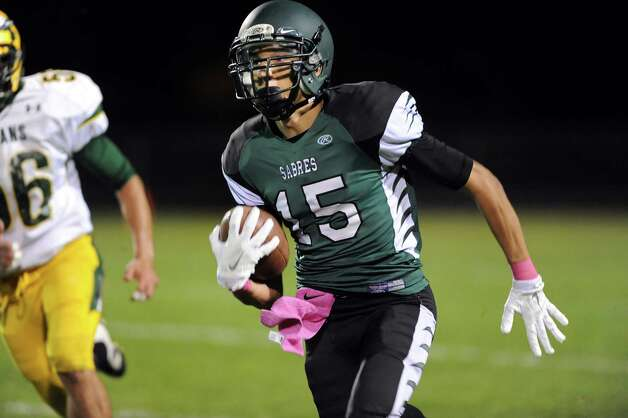 Schalmont's Devin Higgins, right, carries the ball on his way to a touchdown during their football game against Ravena on Friday, Oct. 3, 2014, at Schalmont High in Rotterdam, N.Y. (Cindy Schultz / Times Union) Photo: Cindy Schultz / 00028779A