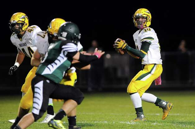 Ravena's quarterback David Warnken, right, looks for an open man during their football game against Ravena on Friday, Oct. 3, 2014, at Schalmont High in Rotterdam, N.Y. (Cindy Schultz / Times Union) Photo: Cindy Schultz / 00028779A