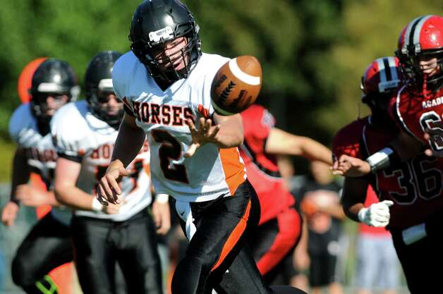 Schuylerville's quarterback William Griffen center, tosses the ball to a teammate as during their football game against Academy on Friday, Oct. 3, 2014, at Albany Academy in Albany, N.Y. (Cindy Schultz / Times Union) Photo: Cindy Schultz / 00028780A