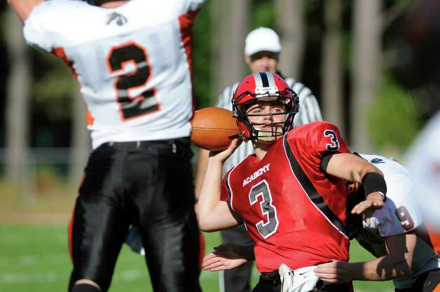 Academy's quarterback Will Bennett, right, readies to throw the ball as Schuylerville's William Griffen defends during their football game on Friday, Oct. 3, 2014, at Albany Academy in Albany, N.Y. (Cindy Schultz / Times Union) Photo: Cindy Schultz / 00028780A