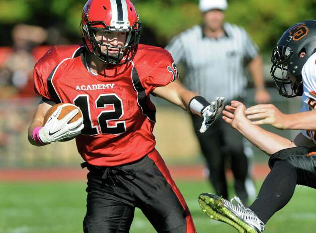Academy's Andrew Martin, left, holds off a Schuylerville defender during their football game on Friday, Oct. 3, 2014, at Albany Academy in Albany, N.Y. (Cindy Schultz / Times Union) Photo: Cindy Schultz / 00028780A