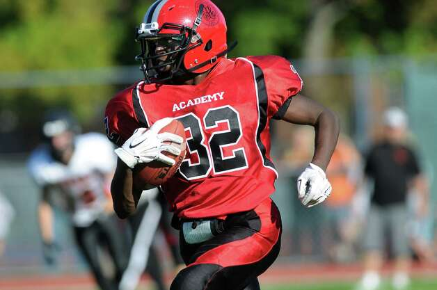 Academy's Lamine Gueye carries the ball during their football game against Schuylerville on Friday, Oct. 3, 2014, at Albany Academy in Albany, N.Y. (Cindy Schultz / Times Union) Photo: Cindy Schultz / 00028780A