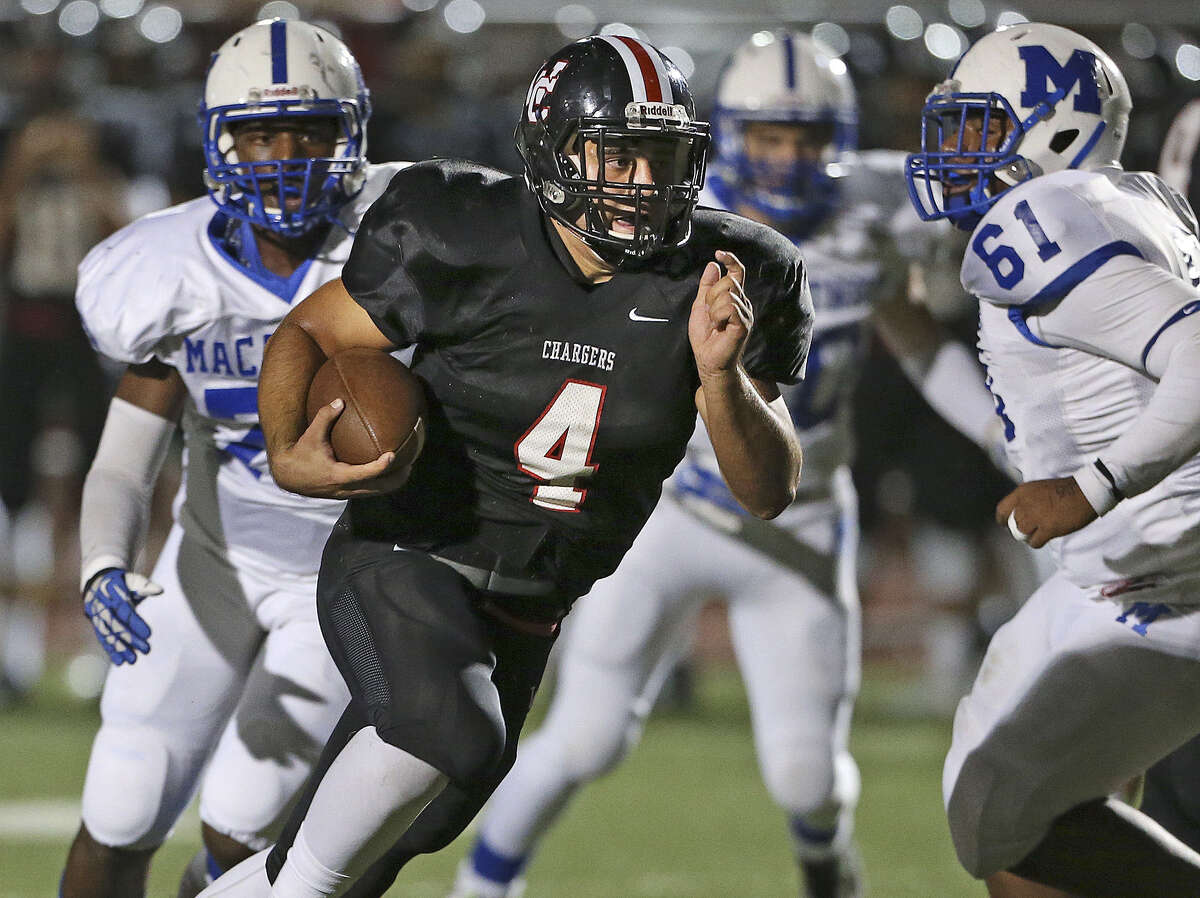 Churchill's Nicholas Smisek, who had 123 yards on 19 carries, including a 17-yard TD run, finds running room up the middle.