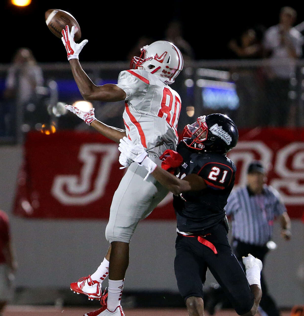 Judson's Michael Akai pulls down a 37-yard pass over Wagner's Jacorey Walker during the first half at Rutledge Stadium.