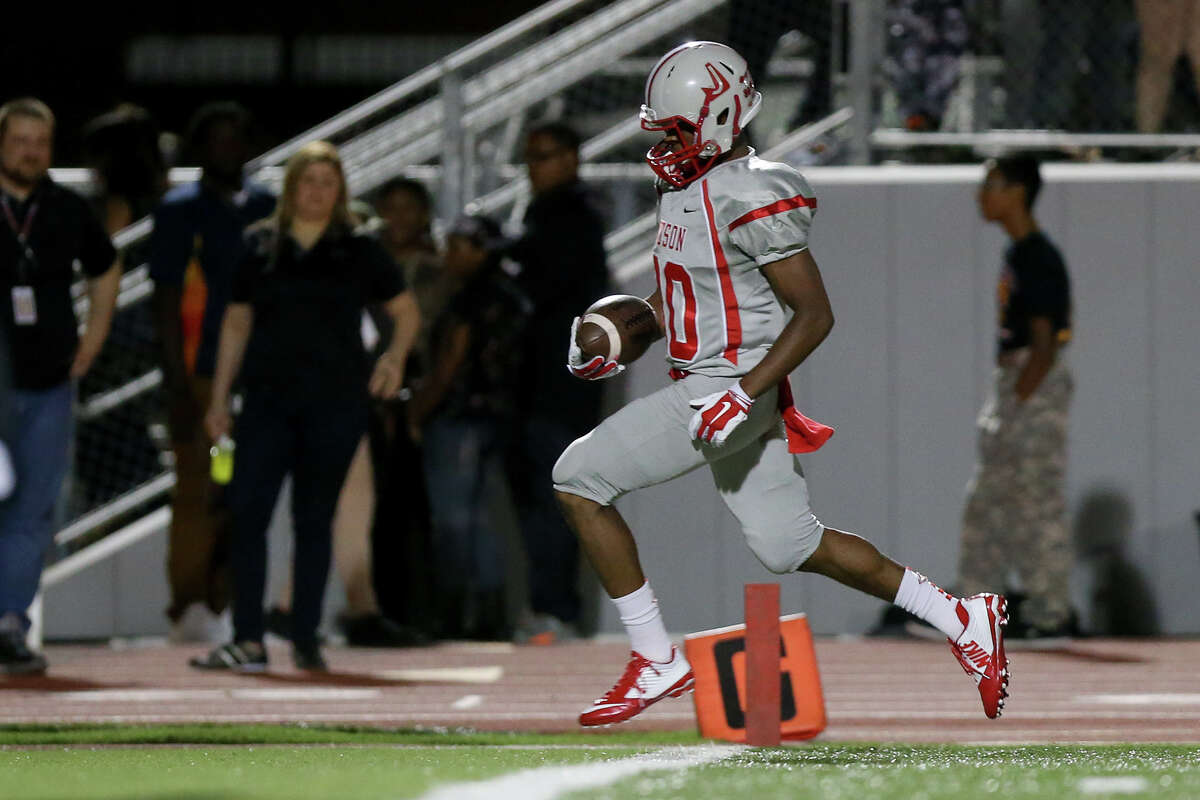 Judson's Michael Akai scores on a 22-yard run during the second half of their game with Wagner in the