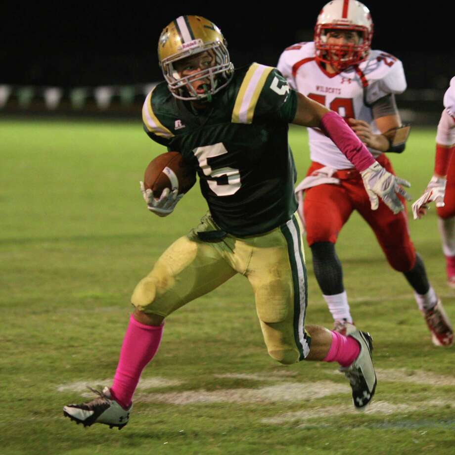 Little Cypress-Mauriceville's Robert Green runs the ball against Splendora at the Bear's stadium Friday night. Photo provided by Kyle Ezell