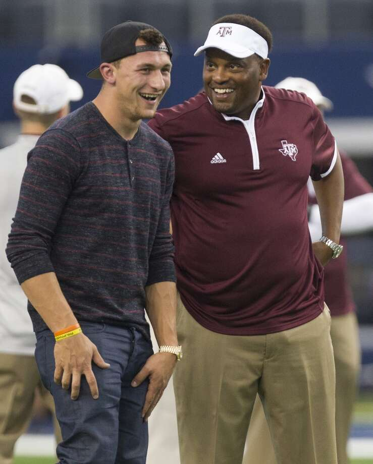 Former Aggies Johnny Manziel talks with Texas A&M Aggies head coach Kevin Sumlin before the Southwest Classic against the Arkansas Razorbacks at AT&T Stadium, Saturday, Sept. 27, 2014, in Arlington . (Cody Duty / Houston Chronicle) Photo: Cody Duty, Houston Chronicle
