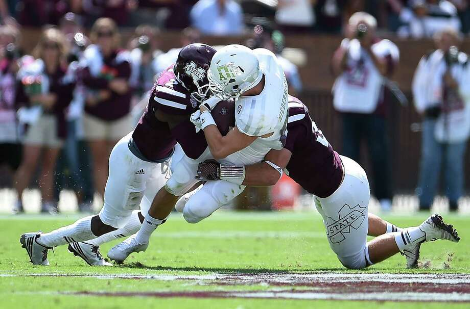 STARKVILLE, MS - OCTOBER 04:  Boone Niederhofer #82 of the Texas A&M Aggies is hit by Will Redmond #2 of the Mississippi State Bulldogs during the second quarter of a game at Davis Wade Stadium on October 4, 2014 in Starkville, Mississippi. Photo: Stacy Revere, Getty Images / 2014 Getty Images