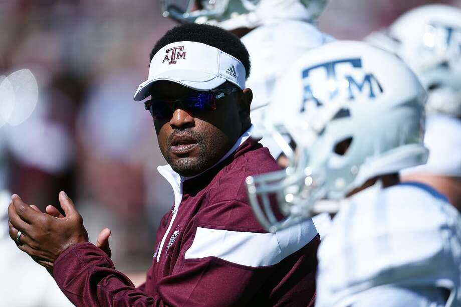 STARKVILLE, MS - OCTOBER 04:  Head coach Kevin Sumlin of the Texas A&M Aggies leads his team onto the field prior to a game against the Mississippi State Bulldogs at Davis Wade Stadium on October 4, 2014 in Starkville, Mississippi.  (Photo by Stacy Revere/Getty Images) Photo: Stacy Revere, Getty Images