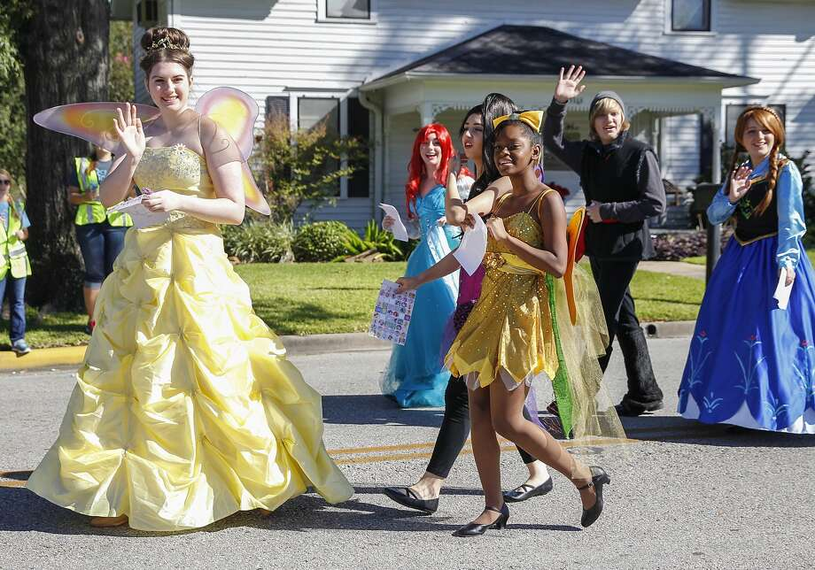 Disney Princesses wave to the crowd during the Katy Rice Harvest Festival Parade held in Old Town Katy on October 4, 2014. Photo: Diana L. Porter, Freelance / © Diana L. Porter
