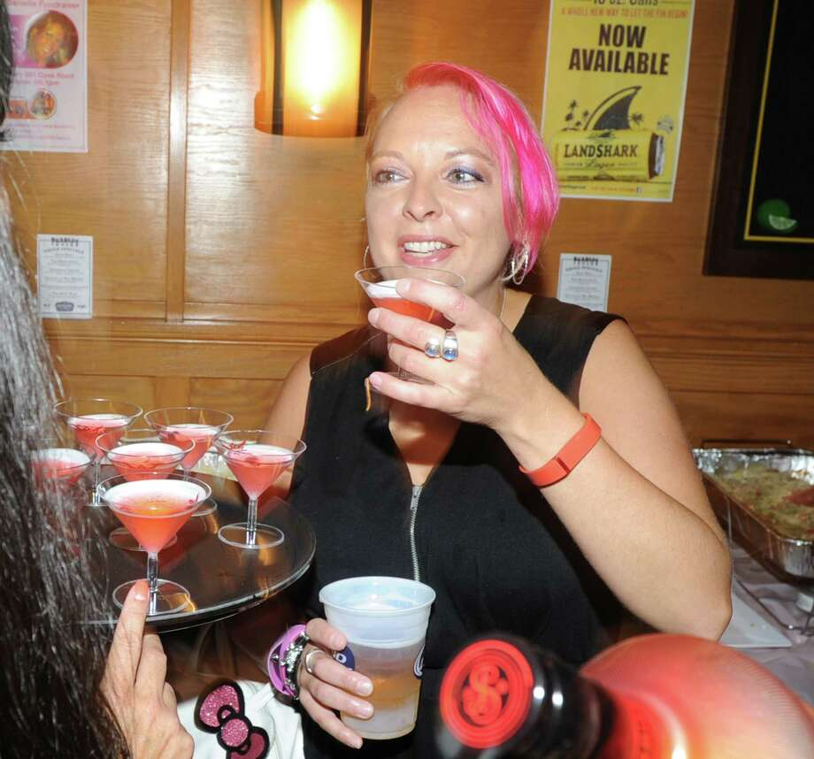 "Cancer benefit for Danielle LaRocque at the Seaside Tavern in Stamford, Conn., Saturday afternoon, Oct. 4, 2014. LaRocque, a Stamford resident, has breast cancer. LaRocque, a former employee of the Seaside Tavern, said she is unable to work due to her treatment. The tavern's sales and tips from the all day benefit ""Do It for Danielle,"" are going toward paying the cost of LaRocque's cancer treatment. Photo: Bob Luckey / Greenwich Time"