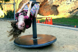 Stella Ramson, 3, takes a spin at Piexotto Playground in Corona Heights Park.