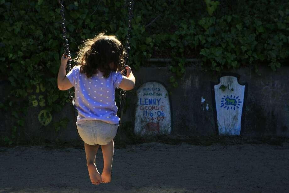 Natasha Olascoaga, age 3, swings on the swing set at Piexotto Playground in the Corona Heights neighborhood in San Francisco, Calif., on Thursday October 2, 2014. Photo: Daniel E. Porter, The Chronicle