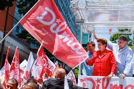 President Dilma Rousseff greets supporters during a rally ahead of Sunday's election.