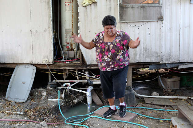 Elida Contreras shows her frustration at the unfinished job left behind by maintenance at her trailer in the Mission Trails mobile home park on Saturday, August 25, 2014. Contreras has lived at the park for 14 years and moved out last week after months of uncertainty. Photo: Lisa Krantz / SAN ANTONIO EXPRESS-NEWS
