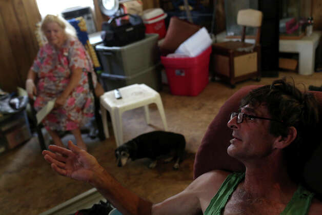 "Carol Thompson and her son, Jeffrey Alan Draper, with their dog, Tickles, talk about being forced to move out of Mission Trails mobile home after living there for 10 years, on Wednesday, August 27, 2014. ""I feel like my mind is in a blender every time I think about it,"" says Draper. Recently they found a park to move to, Lackland Village, and plan to move next week. Photo: Lisa Krantz / SAN ANTONIO EXPRESS-NEWS"